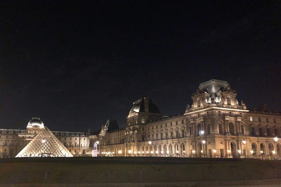 The Louvre Museum Paris illuminated at night
