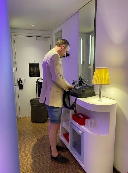 A man stands at the Vanity at the CitizenM Bowery Hotel