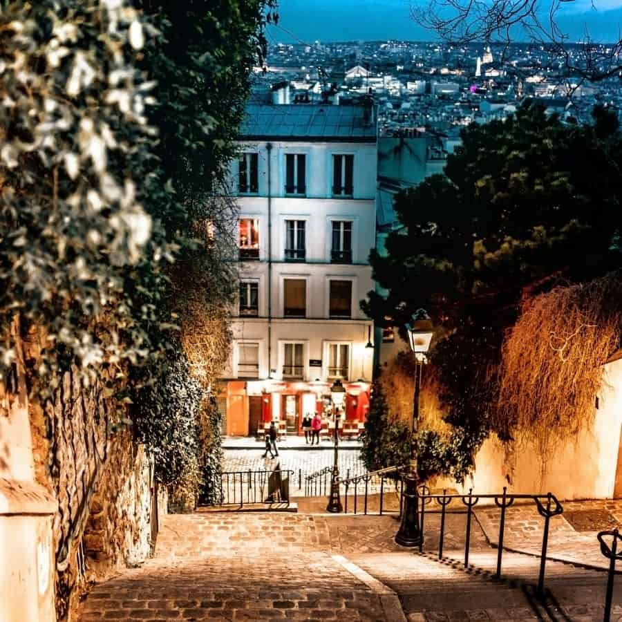 Stairs lead up to the Monmartre district of Paris at night