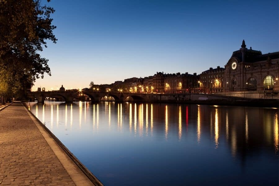 A nightime stroll in Paris along the Seine River across from the Musee D'Orsay