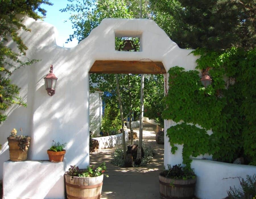 Entrance to El Rey Court, an affordable place to stay on a girls trip to Santa Fe