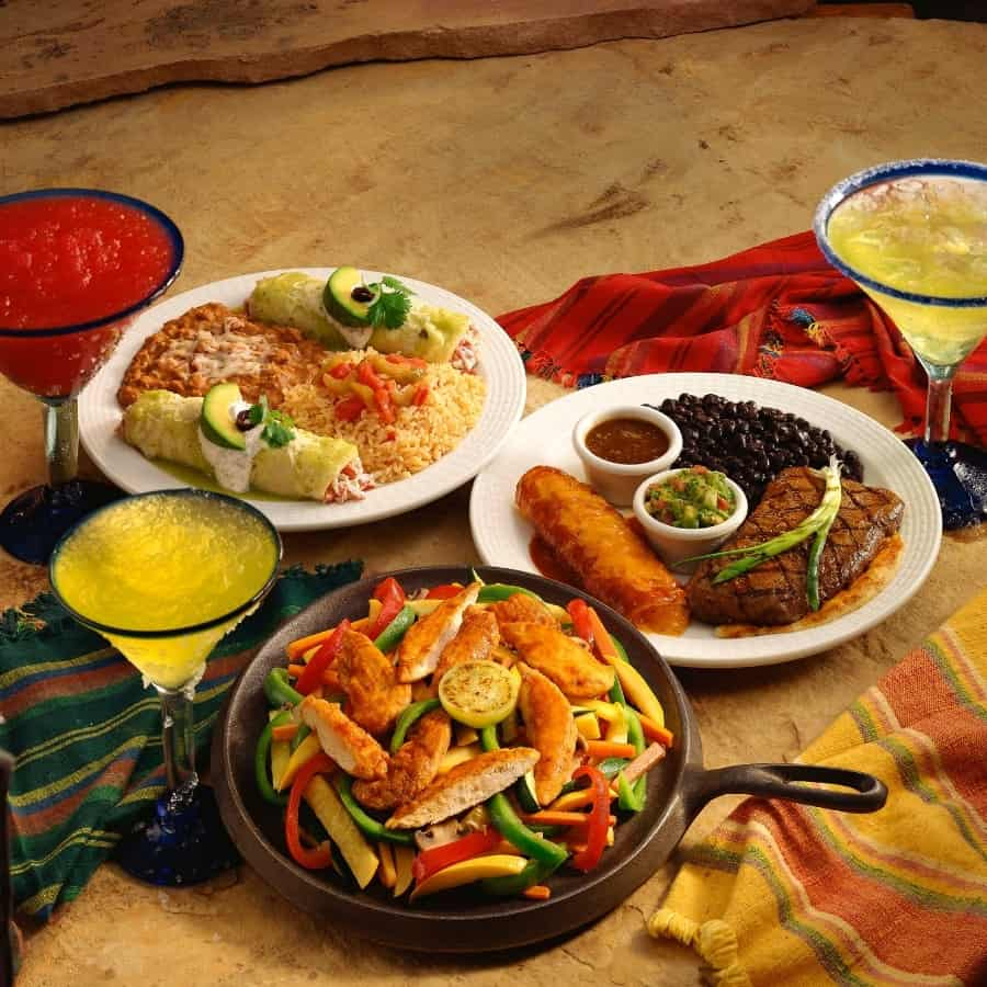 A table is set with an assortment of foods from Southwestern cuisine
