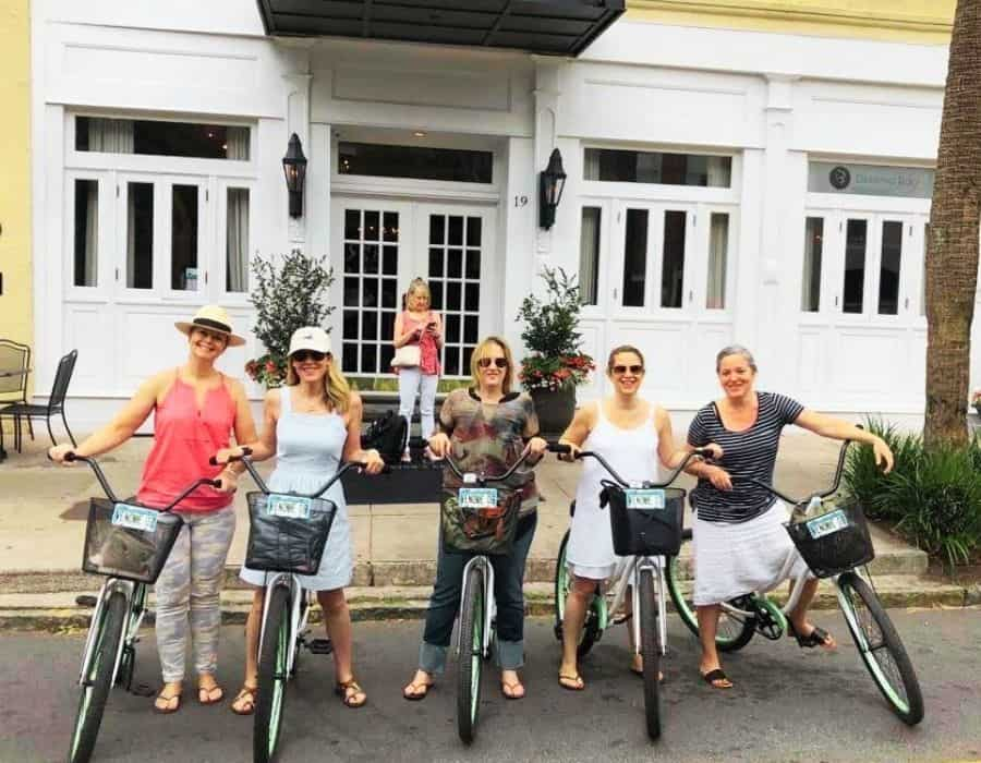 Susan Heinrich and friends on bikes ready to explore Charleston, one of her favourite girls weekend destinations