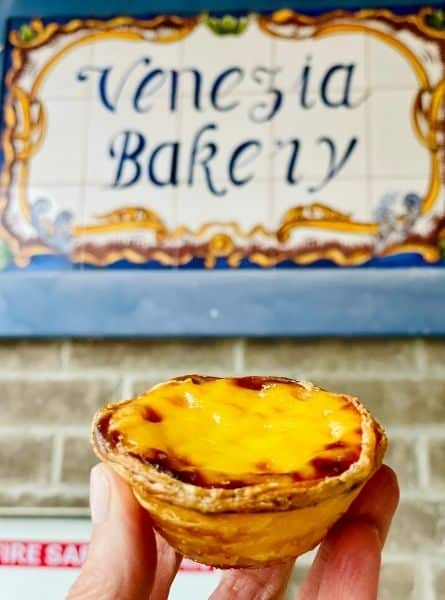 Susan holds a portuguese tart from Venezia bakery in Toronto