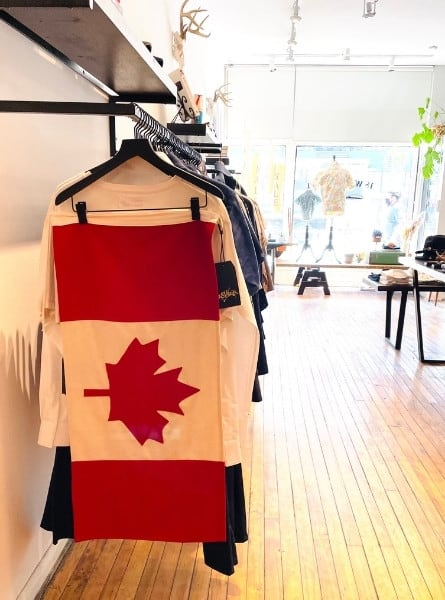 A shop on Queen Street West called 18 Waits with a handmade Canadian flag