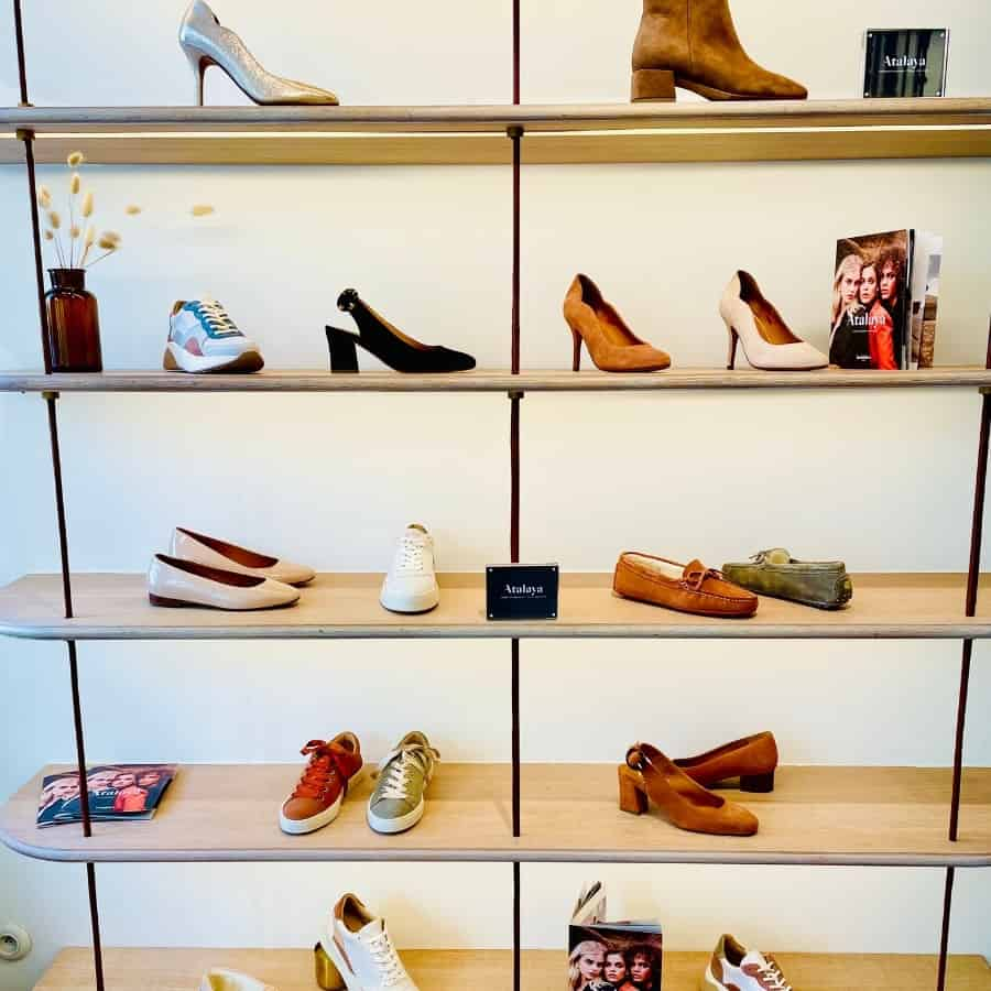 A shelving display filled with a variety of shoes at Bobbies in Paris