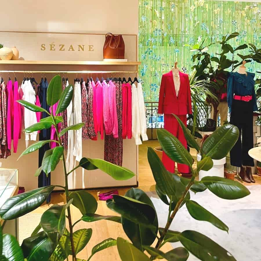 A colourful rack of clothing by Sezane Paris, an affordable French clothing brand