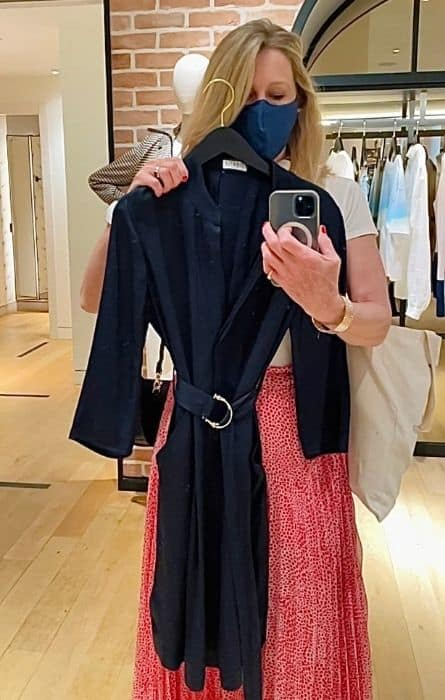 Susan Heinrich holds a navy dress by French clothing brand Claudie Pierlot
