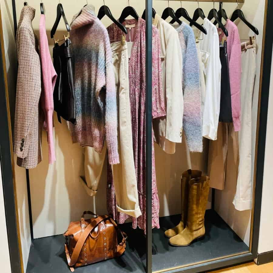 A rack of fall clothes in cream and mauve by Vanessa Bruno, a Paris clothing brand